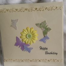 Handmade happy birthday card and envelope embellished with paper flower and butterflies