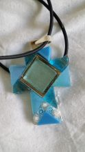 Handmade silver plated cross with aqua glass tiles and millifiori.