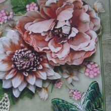 Handmade decoupage cad with flowers and butterfly