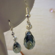 Blue Swarovski crystal drop earrings set with a single silver filigree ball