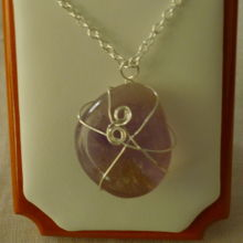 "Beautiful handmade sterling silver setting made around a polished amethyst stone and completed with a 16"" chain."