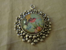Lovely antique silver setting with a vintage art deco cabochon featuring with various colours